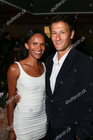 Stock Image of From left, Amanda Luttrell-Garrigus, E and Josh Rosenthal pose during the South Coast Plaza Fall Portfolio catalog launch party held at the Hotel Bel-Air, in Bel Air, Calif