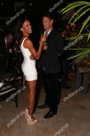 From left, Amanda Luttrell-Garrigus, E and Josh Rosenthal pose during the South Coast Plaza Fall Portfolio catalog launch party held at the Hotel Bel-Air, in Bel Air, Calif