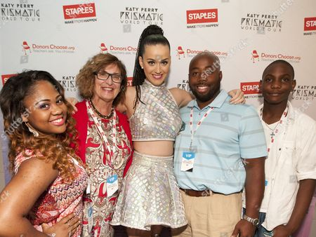 Global pop star Katy Perry, center, with local teachers and students, left to right, Tiara Brooks, Pauline Weisz, Matthew Hall and Jaylin Barber, backstage at the Philips Arena during her Prismatic World Tour performance, in Atlanta, Georgia. As part of its $1 million dollar donation to online charity DonorsChoose.org, Staples announced it has fully-funded the balance of every project on DonorsChoose.org in the Atlanta, GA community. This $128,158 donation helped 77 teachers fulfill classroom needs and helped more than 8,779 students in the Atlanta public school district. Katy Perry teamed up with Staples and DonorsChoose.org to �Make Roar Happen� and support teachers during this back-to-school season