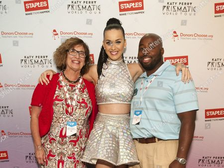 Global pop star Katy Perry with local teachers Pauline Weisz, left, and Matthew Hall, right, backstage at the Philips Arena during her Prismatic World Tour performance, in Atlanta, GA. As part of its $1 million dollar donation to online charity DonorsChoose.org, Staples announced it has fully-funded the balance of every project on DonorsChoose.org in the Atlanta, GA community. This $128,158 donation helped 77 teachers fulfill classroom needs and helped more than 8,779 students in the Atlanta public school district. Katy Perry teamed up with Staples and DonorsChoose.org to �Make Roar Happen� and support teachers during this back-to-school season