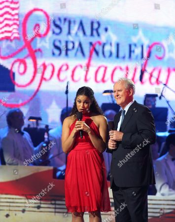 Stock Photo of Jordan Sparks, left, and John Lithgow host the Star-Spangled Spectacular Concert: Bicentennial of Our National Anthem at Pier Six Pavilion, in Baltimore
