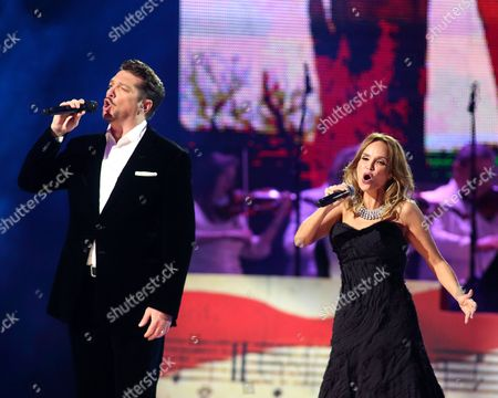Paulo Szot, left, and Kristin Chenoweth perform in concert during the Star-Spangled Spectacular Concert: Bicentennial of Our National Anthem at Pier Six Pavilion, in Baltimore