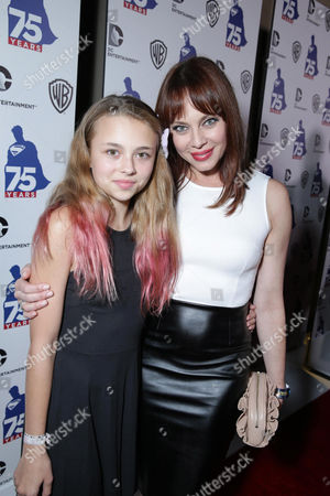 Stock Picture of Catherine Clarke and Melinda Clarke attend the 'Superman' 75th Anniversary Party on Day 3 of 2013 Comic-Con International Convention on in San Diego, Calif