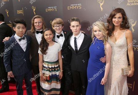 Lance Lim, from left, Tony Cavalero, Breanna Yde, Aidan Miner, Ricardo Hurtado, Jade Pettyjohn, and Jama Williamson arrive at night one of the Television Academy's 2016 Creative Arts Emmy Awards at the Microsoft Theater on in Los Angeles