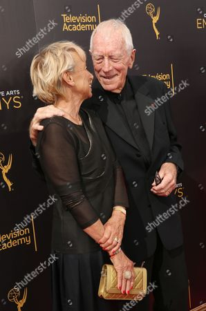 Catherine Brelet, left, and Max von Sydow arrive at night one of the Television Academy's 2016 Creative Arts Emmy Awards at the Microsoft Theater on in Los Angeles