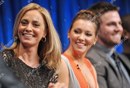 Photo of, from left, Susanna Thompson, Katie Cassidy and Stephen Amell courtesy of Samsung Galaxy, taken during the Paley Center for Media's PaleyFest, honoring Arrow at the Saban Theatre, in Los Angeles, California