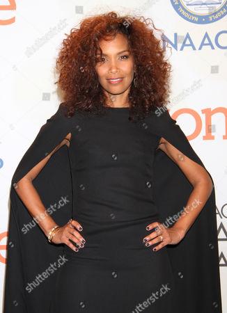 Mara Brock Akil poses in the press room at the 46th NAACP Image Awards at the Pasadena Civic Auditorium, in Pasadena, Calif