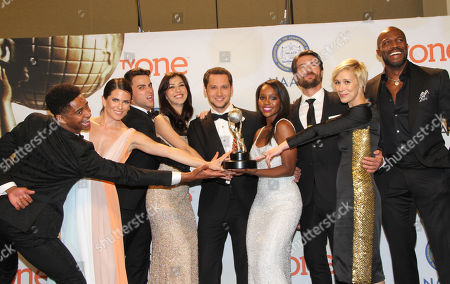 Alfred Enoch, from left, Karla Souza, Jack Falahee, Katie Findlay, Matt McGorry, Aja Naomi King, Charlie Weber, Liza Weil, and Billy Brown poses in the press room with the award for outstanding drama series for â?oeHow to Get Away with Murderâ?? at the 46th NAACP Image Awards at the Pasadena Civic Auditorium, in Pasadena, Calif
