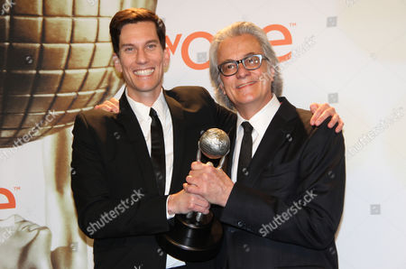 Peter Nowalk, left, and Bill D'Elia pose in the press room with the award for outstanding drama series for How to Get Away with Murder at the 46th NAACP Image Awards at the Pasadena Civic Auditorium, in Pasadena, Calif