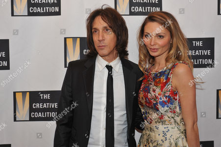 Warren Tricomi, left, and Gia Skova arrive at the Creative Coalition Inaugural Ball, in Washington