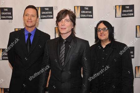 The Goo Goo Dolls, from left to right, Mike Malinin, John Rzeznik and Robby Tacak arrive at the Creative Coalition Inaugural Ball, in Washington