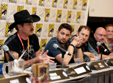 """From left, Gary Hartle, David Colman, Andrew Robinson, Drew Nolosco and Brian Lenard participate in the """"Kaijudo: Rise of the Duel Masters"""" panel at Comic-Con, in San Diego, Calif"""