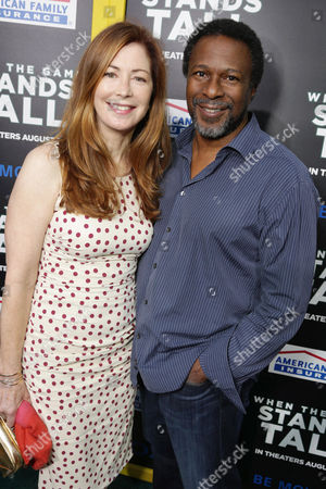 Dana Delany and Director Thomas Carter seen at The World Premiere of Tri Star Pictures' 'When The Game Stands Tall' at ArcLight Cinemas Hollywood, in Los Angeles