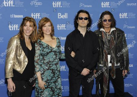"From left, director Amy Berg, producer Lorri Davis, producer Damien Echols, and actor Johnny Depp participate in a photo call and press conference for the film ""West of Memphis"" at TIFF Bell Lightbox during the Toronto International Film Festival on in Toronto"
