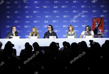 "From left, moderator Thom Powers, director Amy Berg, producer Damien Echols, producer Lorri Davis, and actor Johnny Depp participate in a photo call and press conference for the film ""West of Memphis"" at TIFF Bell Lightbox during the Toronto International Film Festival on in Toronto"