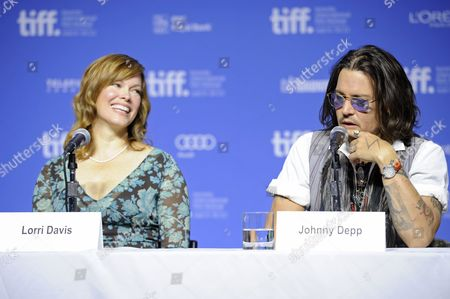 "From left, producer Lorri Davis and actor Johnny Depp participate in a photo call and press conference for the film ""West of Memphis"" at TIFF Bell Lightbox during the Toronto International Film Festival on in Toronto"