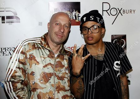 "Steve Lobel and Bobby Brackins arrive at UK ""X Factor"" singing sensation Luigiano Paals single release party for ""Girls, Girls, Girls"" featuring Snoop Lion on at Roxbury nightclub in Los Hollywood, California"