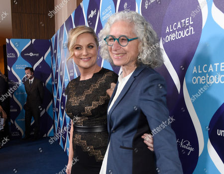 Amy Poehler, left, and Dr. Jane Aronson arrive at unite4:good and Variety's 2nd annual unite4:humanity at the Beverly Hilton Hotel on Thursday, Feb.19, 2015, in Beverly Hills, Calif