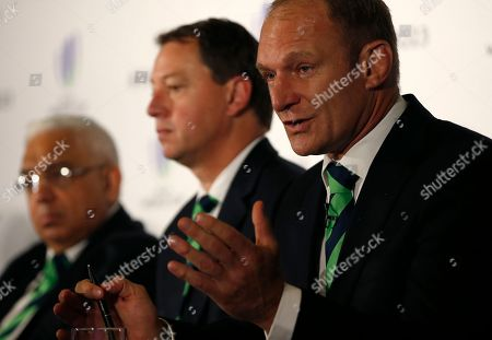 Francois Pienaar, former captain of the South African rugby union team, right, speaks at a press conference after helping to present the South African bid for the 2023 Rugby World Cup in London, . Three competing countries South Africa, Ireland and France will bid for the rights to hold the RWC in 2023, following the next RWC which will be held in Japan in 2019