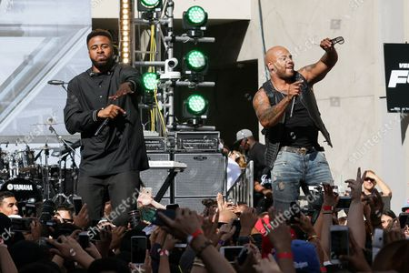 """Flo Rida, left, and Sage The Gemini performs on stage at the """"Furious 7"""" Takeover held at the Revolt Live Studios, in Los Angeles"""