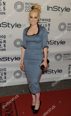 Actress Charlotte Sullivan poses at the 13th Annual InStyle and Hollywood Foreign Press Association Toronto International Film Festival Party, in Toronto