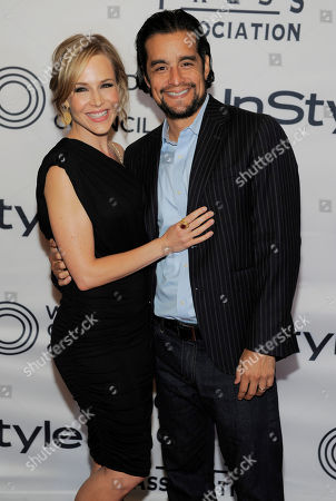 Actress Julie Benz and her husband Rich Orosco pose together at the 13th Annual InStyle and Hollywood Foreign Press Association Toronto International Film Festival Party, in Toronto