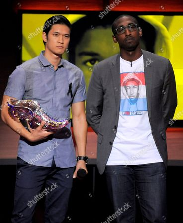 Harry Shum Jr., left, presents an award to nominee Daniel Maree at the Do Something Awards at the Avalon, in Los Angeles