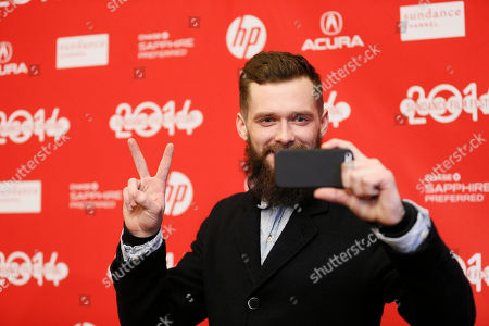 """Cast member Grigoriy Dobrygin records with his mobile phone at the premiere of the film """"A Most Wanted Man"""" during the 2014 Sundance Film Festival, on in Park City, Utah"""