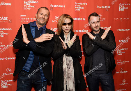 Yoshiki, center, co-founder of the Japanese heavy metal band X Japan, makes the X symbol with 'We Are X' producer John Battsek, left, and director Stephen Kijak at the premiere of the documentary film at the 2016 Sundance Film Festival, in Park City, Utah