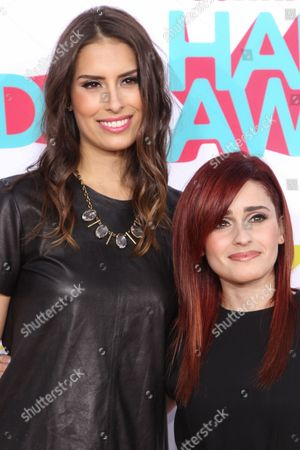 Stock Picture of DJs Claire Schlissel (L) and Jen Mozenter (The Jane Doze) arrive at the 5th Annual TeenNick HALO Awards at the Hollywood Palladium on in Hollywood, Calif