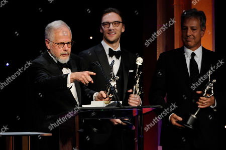 Stock Picture of From left, Jay Cassidy, Crispin Struthers and Alan Baumgarten accept the best edited feature film - comedy or musical award for American Hustle at the 64th Annual ACE Eddie Awards,, in Beverly Hills, Calif