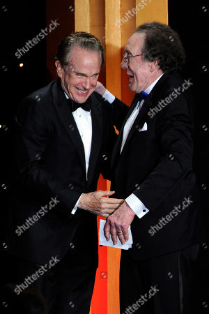 Warren Beatty, left, presents the career achievement award to Robert C. Jones at the 64th Annual ACE Eddie Awards,, in Beverly Hills, Calif
