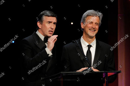 David O. Russell, left, and William Goldenberg speak on stage at the 64th Annual ACE Eddie Awards,, in Beverly Hills, Calif