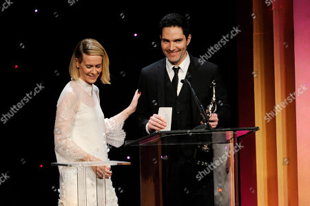 Stock Picture of Sarah Paulson, left, presents the best edited documentary - television award to Chris A. Peterson for The Assassination of President Kennedy at the 64th Annual ACE Eddie Awards,, in Beverly Hills, Calif
