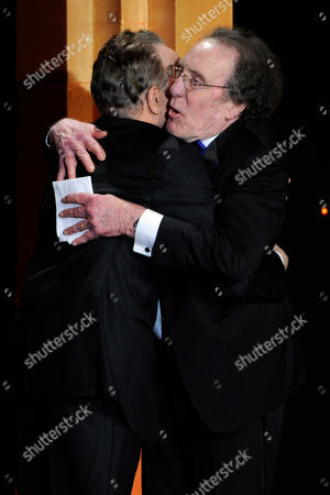 Stock Photo of Warren Beatty, left, hugs Robert C. Jones after presenting him with the career achievement award at the 64th Annual ACE Eddie Awards,, in Beverly Hills, Calif
