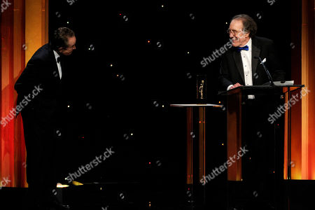 Robert C. Jones, right, accepts the career achievement award at the 64th Annual ACE Eddie Awards,, in Beverly Hills, Calif. Looking on from left, Warren Beatty