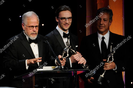 From left, Jay Cassidy, Crispin Struthers and Alan Baumgarten accept the best edited feature film - comedy or musical award for American Hustle at the 64th Annual ACE Eddie Awards,, in Beverly Hills, Calif