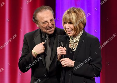 Cynthia Weil, left, and Barry Mann accept the BMI Icon award at the 64th annual BMI Pop Awards at the Beverly Wilshire Hotel, in Beverly Hills, Calif