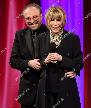 Barry Mann, left, and Cynthia Weil accept the BMI Icon award at the 64th annual BMI Pop Awards at the Beverly Wilshire Hotel, in Beverly Hills, Calif