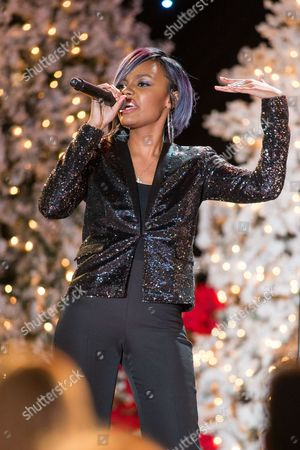Sierra Aylina McClain of the McClain Sisters performs on stage at the Hollywood Christmas Parade, on Sunday, December, 1, 2013 in Los Angeles
