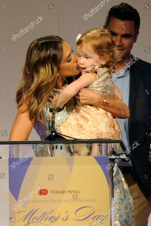 Actress Jessica Alba gives her daughter Haven Garner Warren a kiss as she accepts her Mother of the Year award at the 85th Helping Hand of Los Angeles Mother's Day Luncheon, in Beverly Hills, Calif. Looking on in the background is Alba's husband Cash Warren