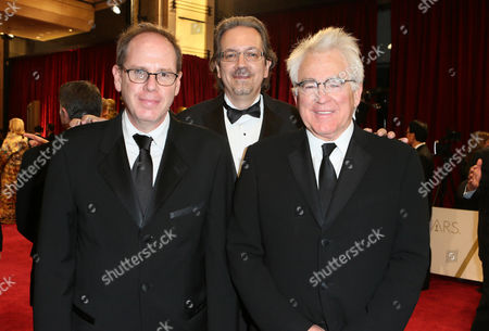Albert Berger, Bob Nelson, and Ron Yerxa arrive at the Oscars, at the Dolby Theatre in Los Angeles