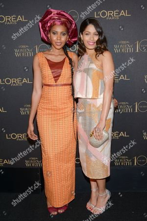 "Honoree and Safe Hands For Girls founder Jaha Dukureh, left, and actress Freida Pinto pose together at the tenth annual L'Oreal Paris ""Women of Worth"" awards gala at The Pierre Hotel, in New York"