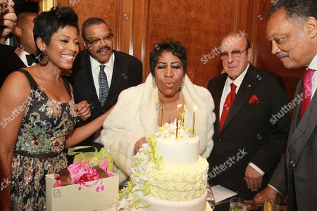 Stock Picture of Reporter Tamron Hall, from left, Willie Wilkerson, singer Aretha Franklin, music executive Clive Davis and Rev. Jesse Jackson Sr. attend Aretha Franklin's 74th Birthday Celebration at the Ritz-Carlton, in New York