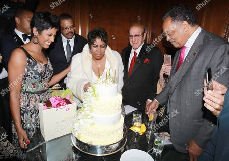 Reporter Tamron Hall, from left, Willie Wilkerson, singer Aretha Franklin, music executive Clive Davis and Rev. Jesse Jackson Sr. attend Aretha Franklin's 74th Birthday Celebration at the Ritz-Carlton, in New York