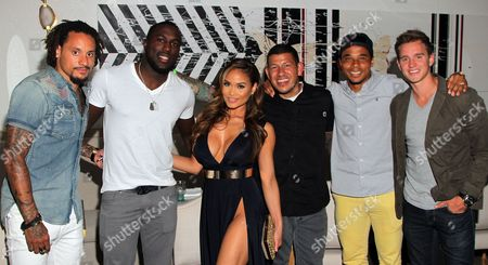 L-R) Soccer players Jermaine Jones, Jozy Altidore, model Daphne Joy, Nick Rimando, Charlie Davies and Stuart Holden seen at Audi Celebrates Jermaine Jones of the U.S. National Soccer Team During 2014 ESPY Weekend at Herringbone at Mondrian, in West Hollywood, California