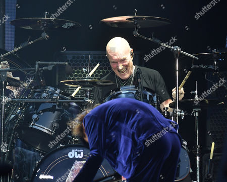 Chris Slade, drummer of the band AC/DC performs at the Olympic Stadium in London