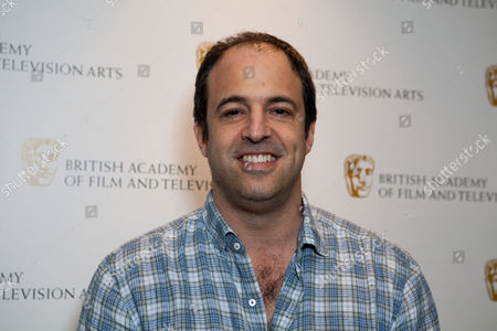 Film Producer Simon Chinn poses for photographers at the BAFTA Breakthrough Brits Jury photo call in central London on