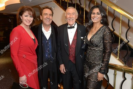 "From left, Rosemarie Ford, Robert Lindsay, Bruce Forsyth and Wilnelia Merced pose for photographers at the after party for the opening night of the ""Dirty Rotten Scoundrels"" musical in the Savoy Hotel in London"