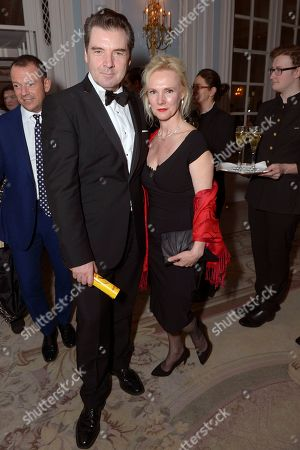 """Brendan Coyle and Joy Harrison pose for photographers at the after party for the opening night of the """"Dirty Rotten Scoundrels"""" musical in the Savoy Hotel in London"""